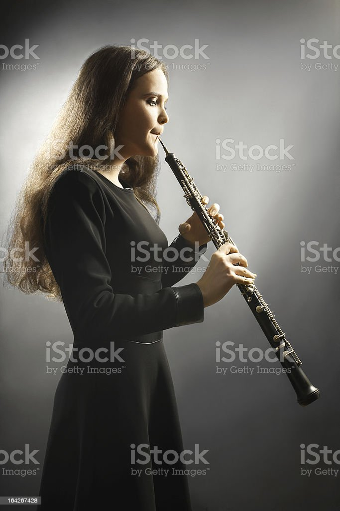 Classical musician oboe musical instrument playing. stock photo