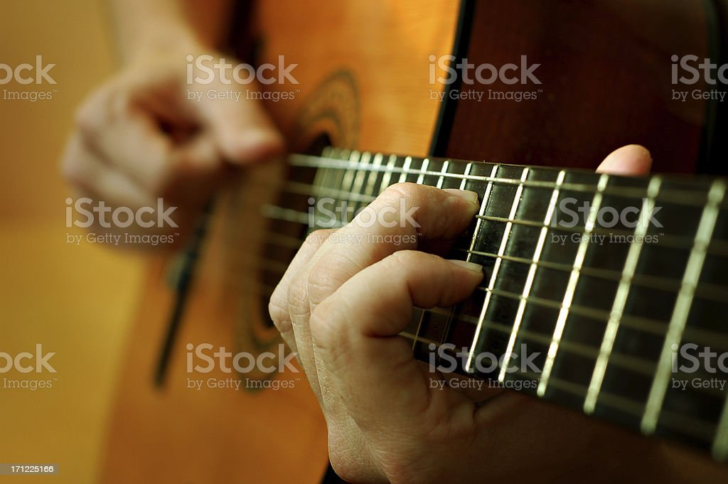 classical spanish guitar being played stock photo