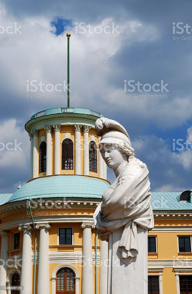 Classical statue and building royalty-free stock photo