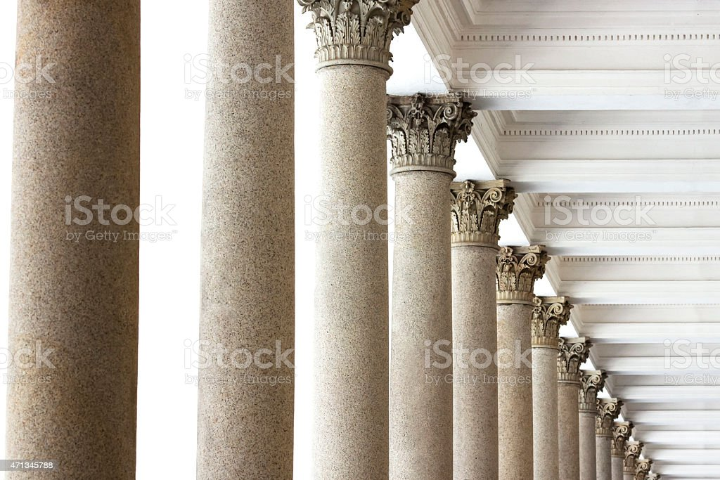 Classical style columns, top part with ceiling and white background stock photo