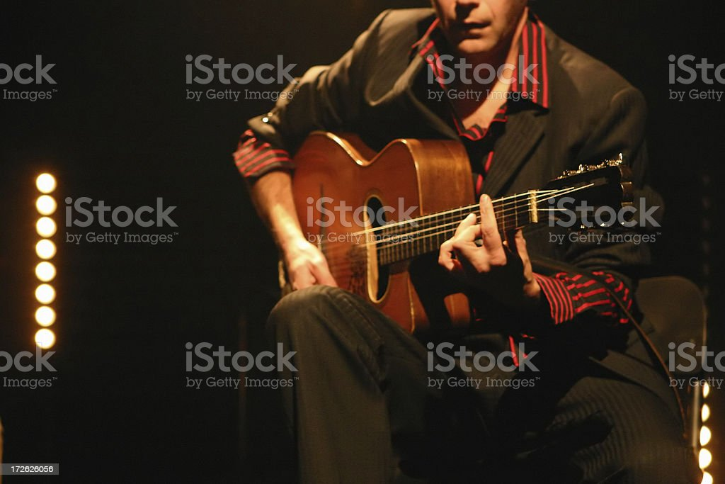 Classical/Acoustic Guitarist on Stage stock photo