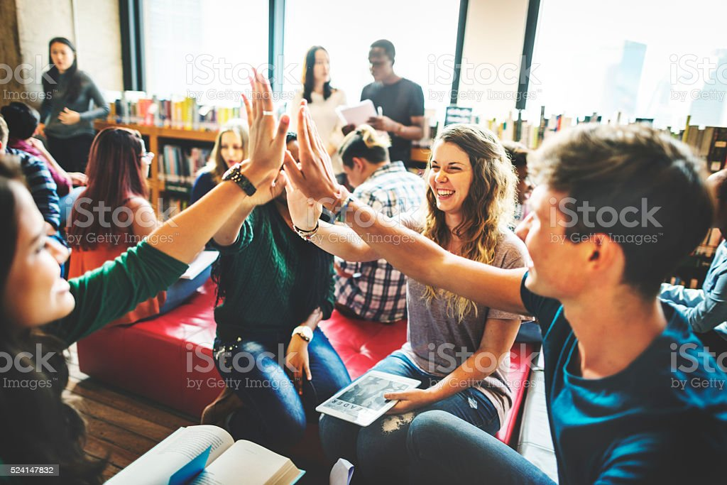 Classmate Classroom Sharing International Friend Concept stock photo