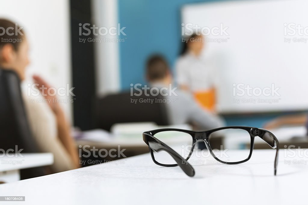 Classroom and students through eyeglasses royalty-free stock photo