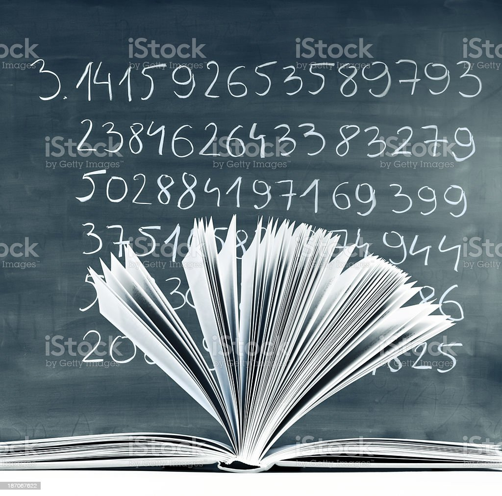 Classroom, open book against hand-written Pi numbers on green chalkboard stock photo