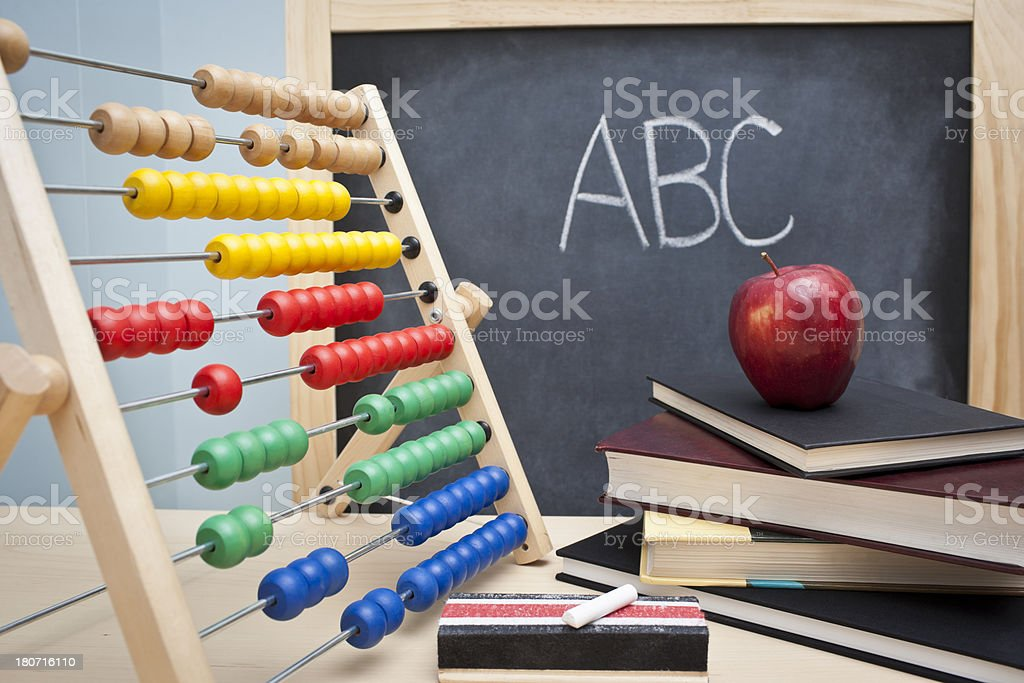 Classroom picture including abacus, books and blackboard royalty-free stock photo