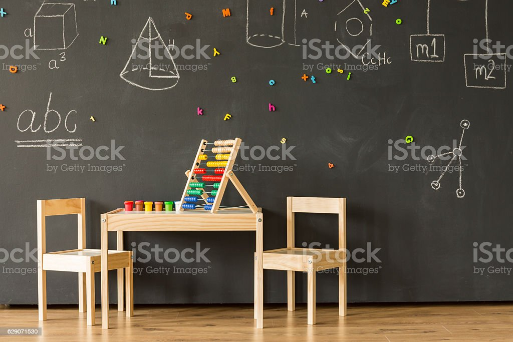 Classroom with blackboard and little furniture stock photo