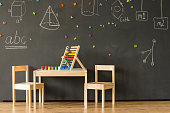 Classroom with blackboard and little furniture
