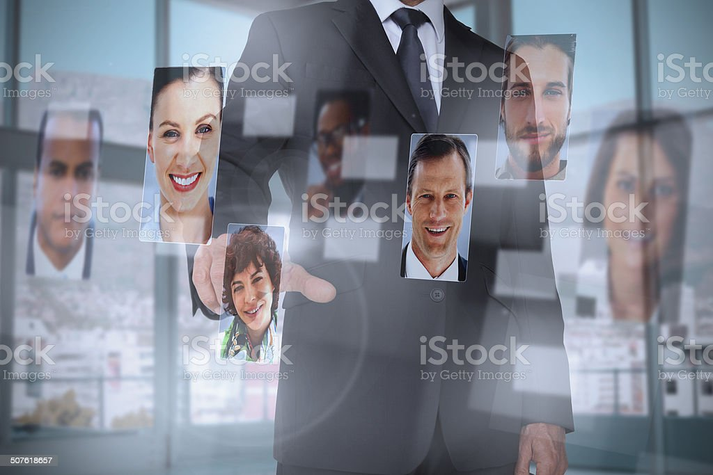 Classy businessman presenting profile pictures stock photo