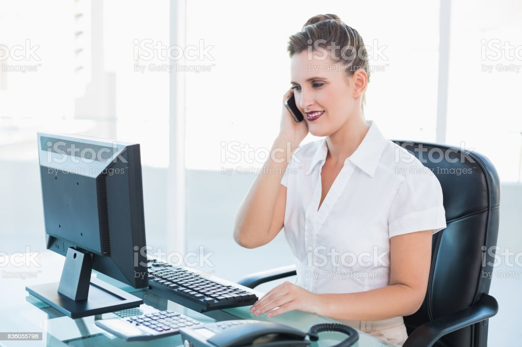 Classy businesswoman having a phone call stock photo