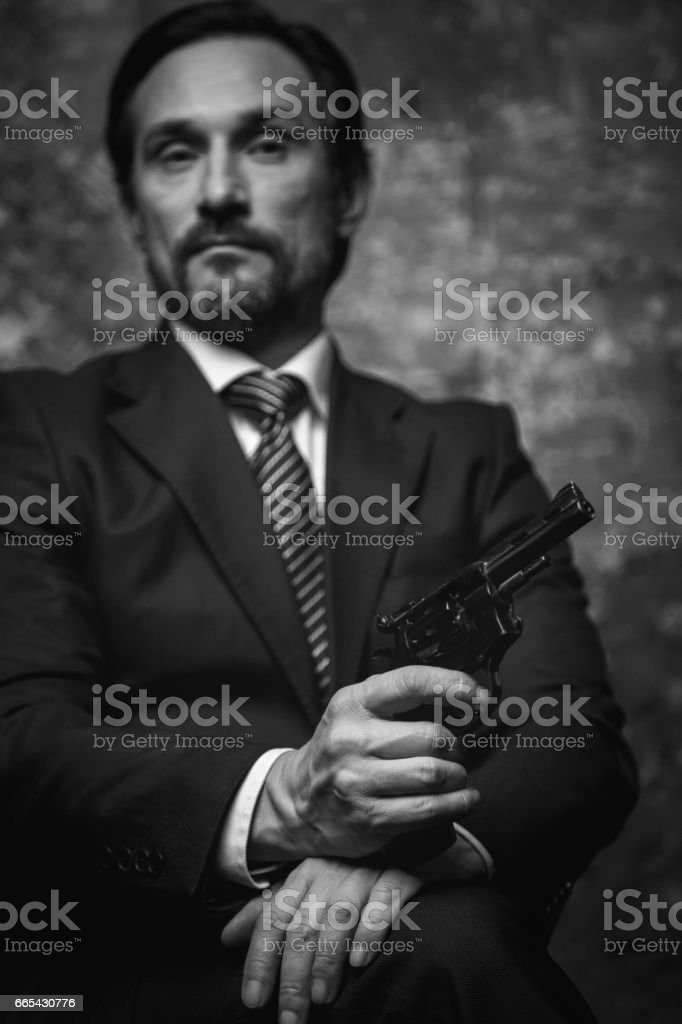 Classy crime lord looking confident stock photo