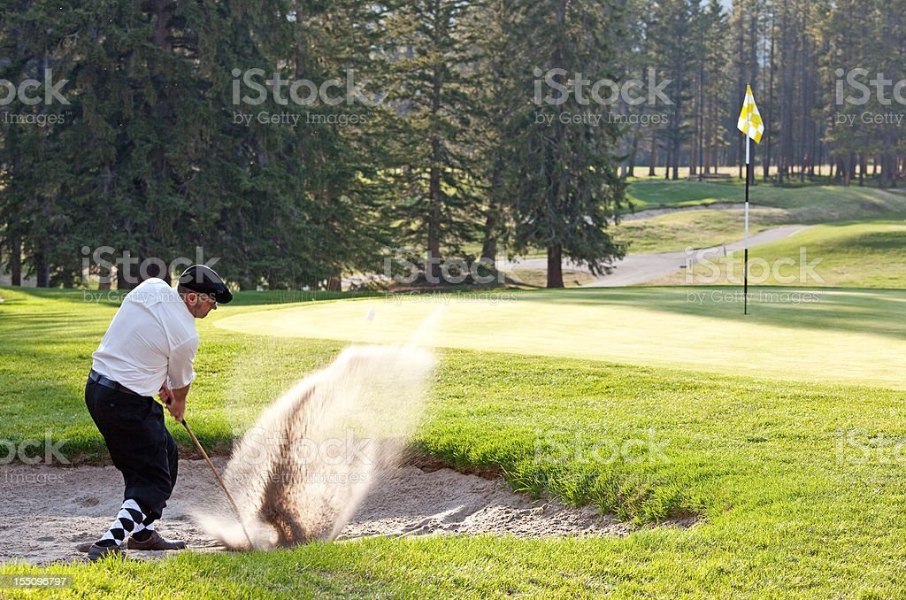 Classy Male Caucasian Golfer Hitting Bunker Shot stock photo
