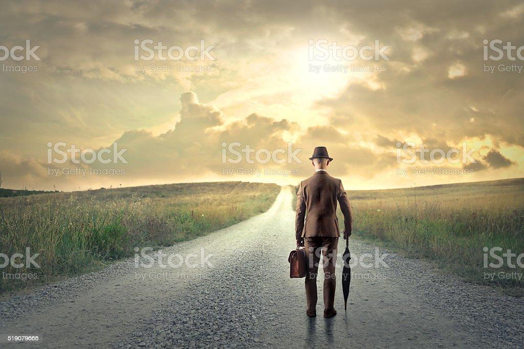 Classy retro man walking on a road stock photo