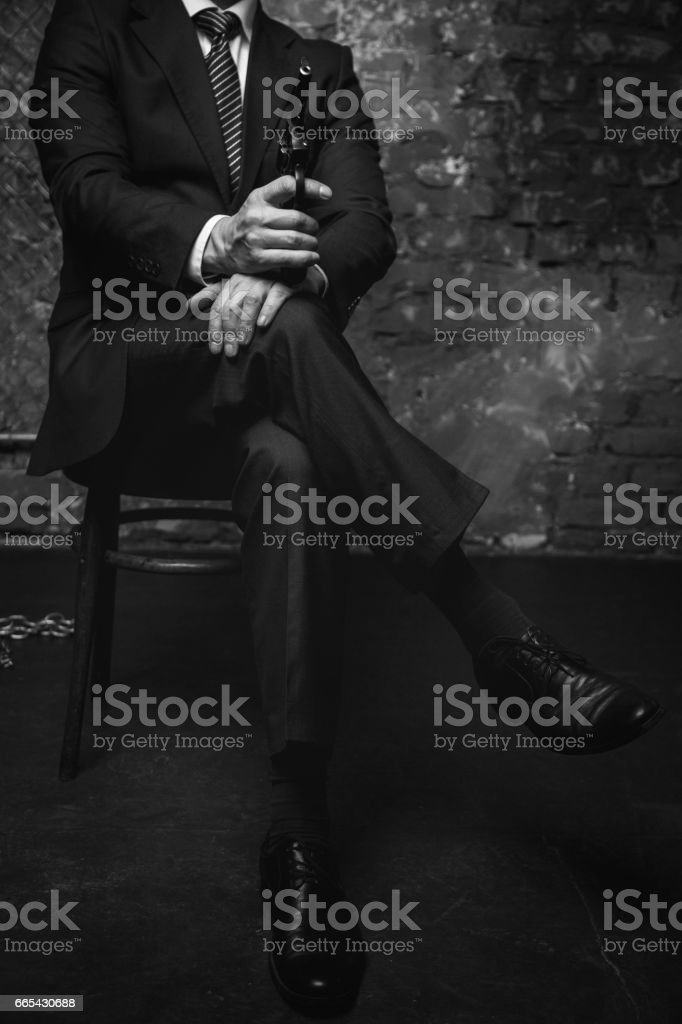 Classy wicked businessman threatening his rivals stock photo