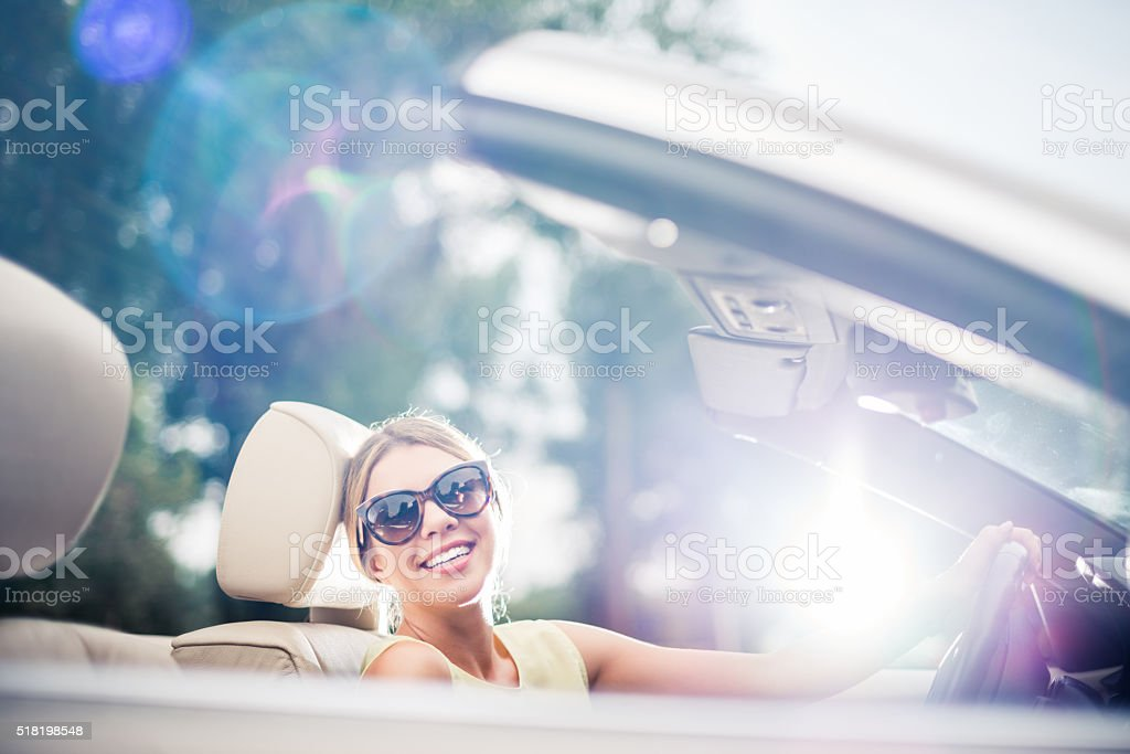 Classy woman driving a car stock photo