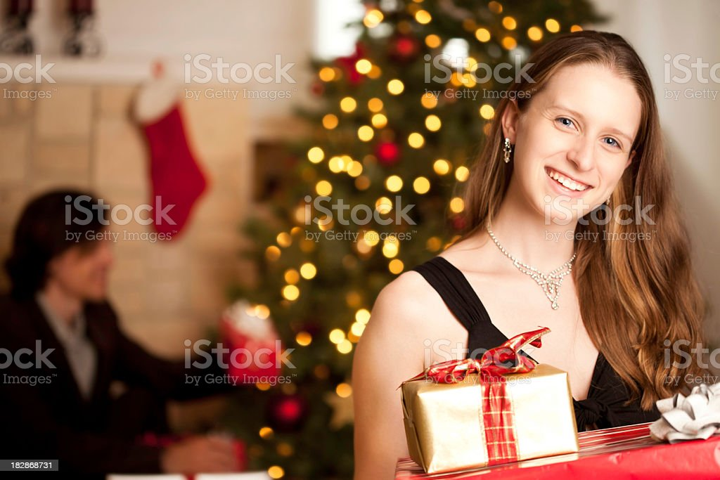Classy Woman Holding Presents While Preparing for Christmas royalty-free stock photo