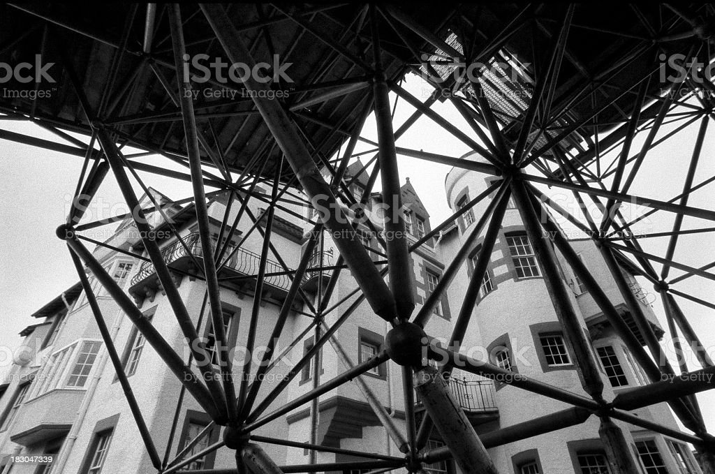 Claustrofobia - Construction truss in front of Scottish building stock photo