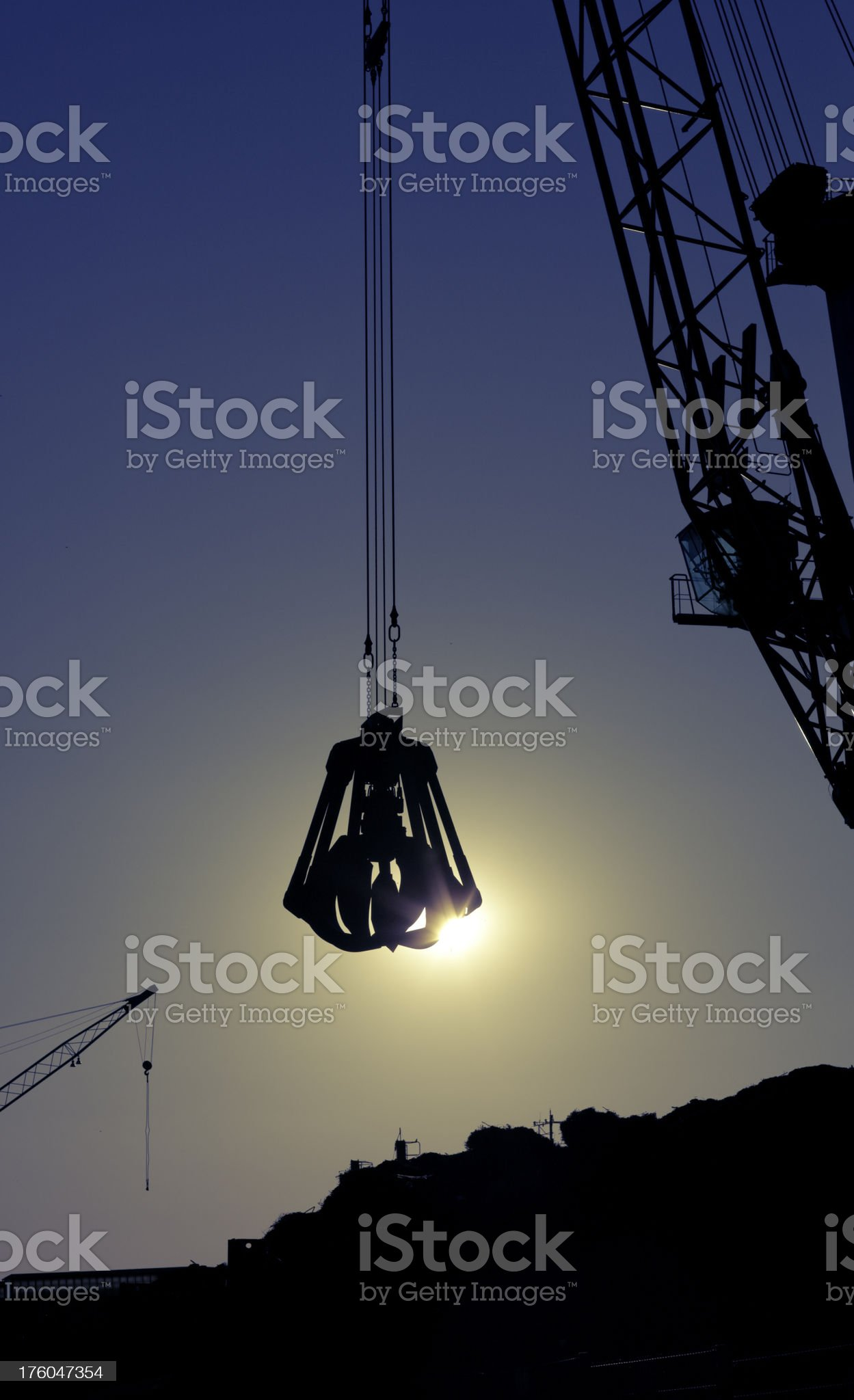 claw above scrap heap royalty-free stock photo