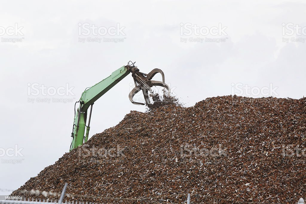 Claw Crane Dumping Recycled Shredded Scrap Metal royalty-free stock photo