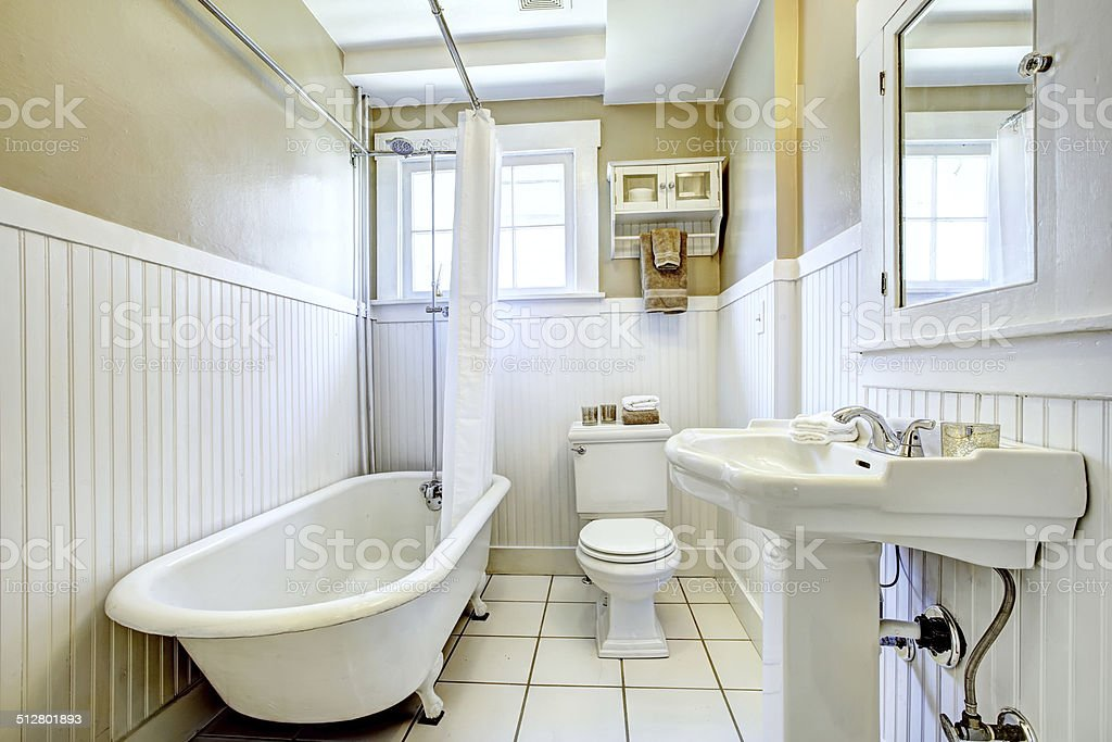 Claw foot tub in white bathroom stock photo