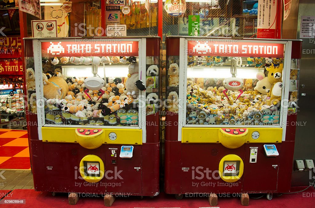 Claw Game or cabinet catches the doll stock photo