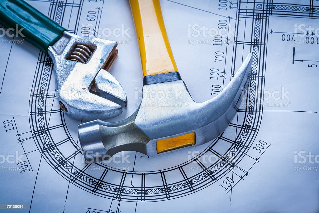 Claw hammer adjustable spanner on blueprint building and archite stock photo