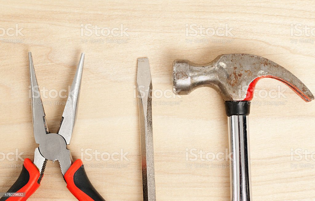 Claw Hammer, Screwdriver, and Pliers stock photo