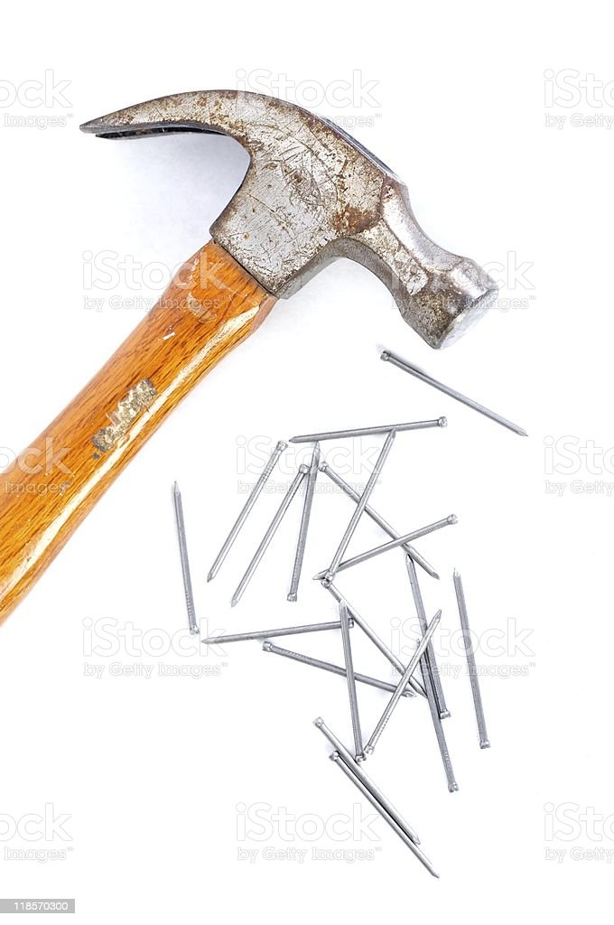 claw hammer with finishing nails stock photo