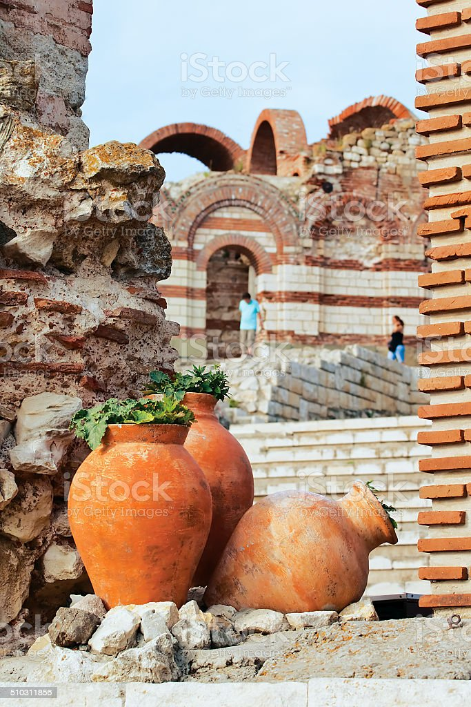 Clay amphora with plants stock photo