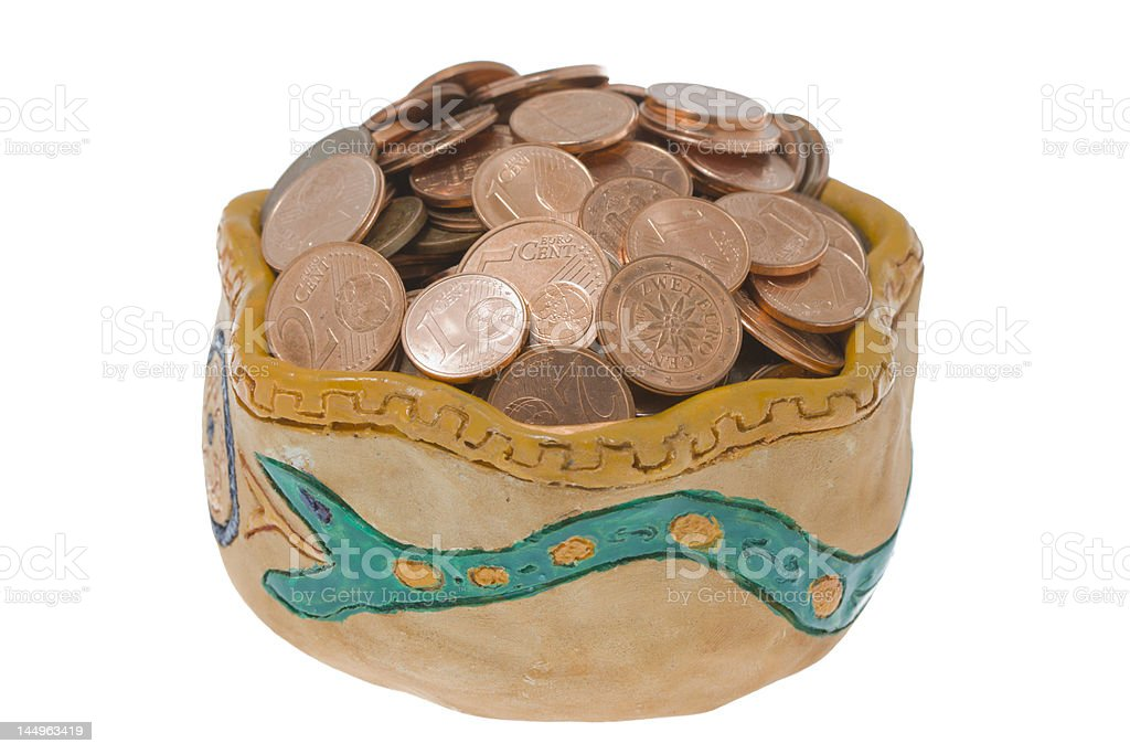 Clay bowl with coins stock photo