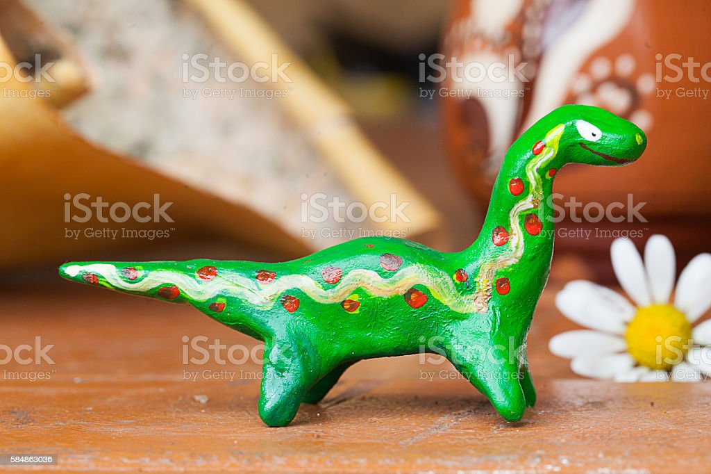 clay ceramic toy dinosaur still life beautiful cute kids long stock photo