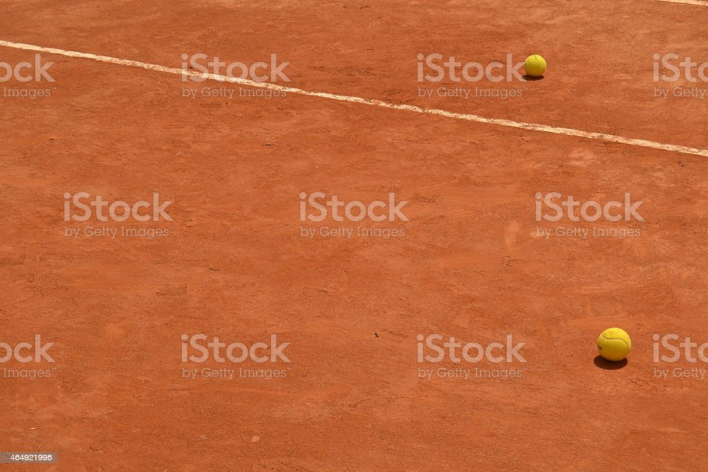 Clay court and tennis balls stock photo