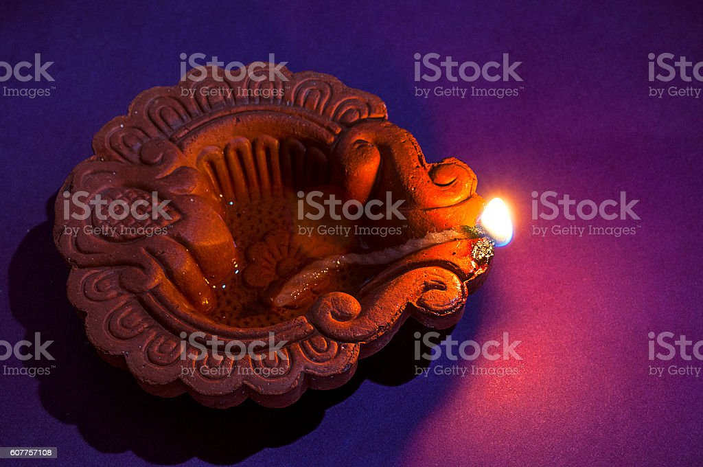Clay diya lamps lit during Diwali Celebration. Greetings Card Design stock photo