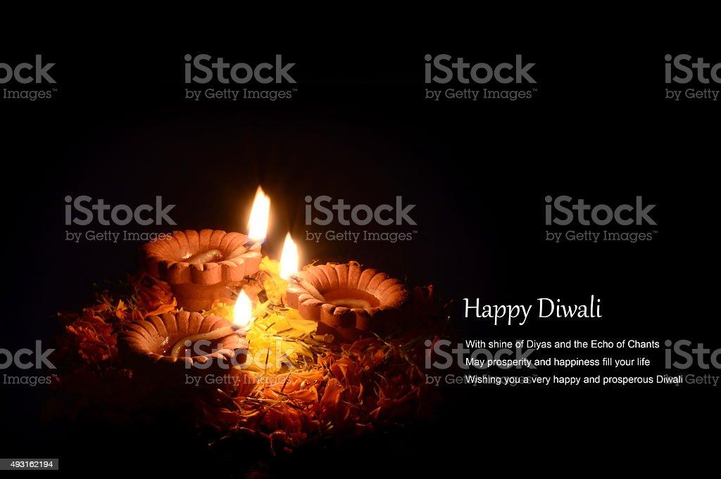 Clay diya lamps lit during diwali celebration. Greetings Card. stock photo