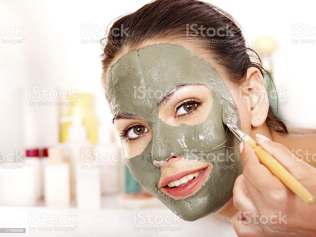 Clay facial mask in beauty spa. royalty-free stock photo
