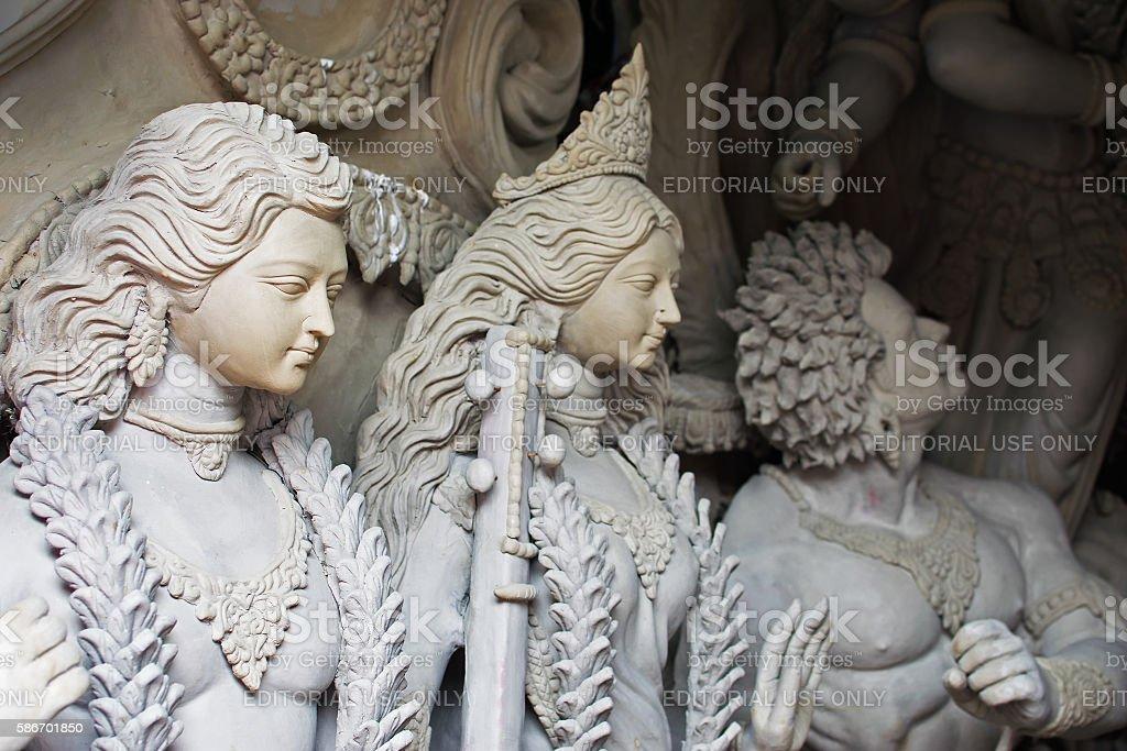 Clay idol of Lord Kartik, Goddess Laxmi and Asura (demon) stock photo