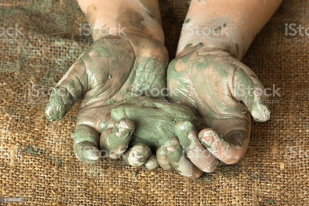clay in the hands of child stock photo