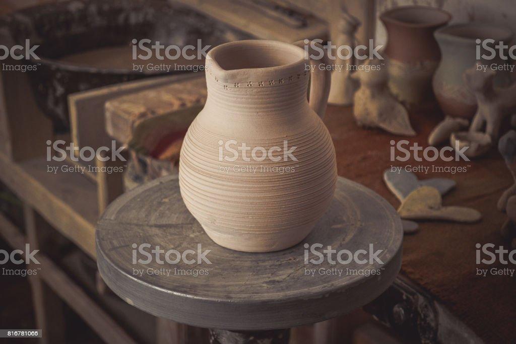 Clay jug on a potter's wheel stock photo