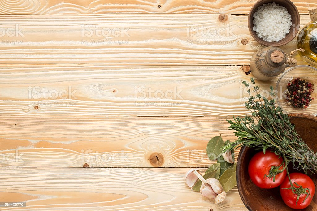 clay plate with tomatoes, herbs, thyme, rosemary, top view stock photo