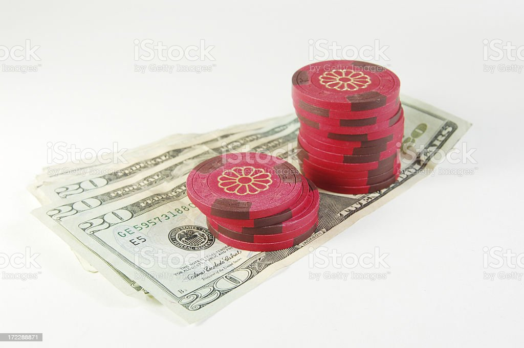 Clay poker chips on cash stock photo