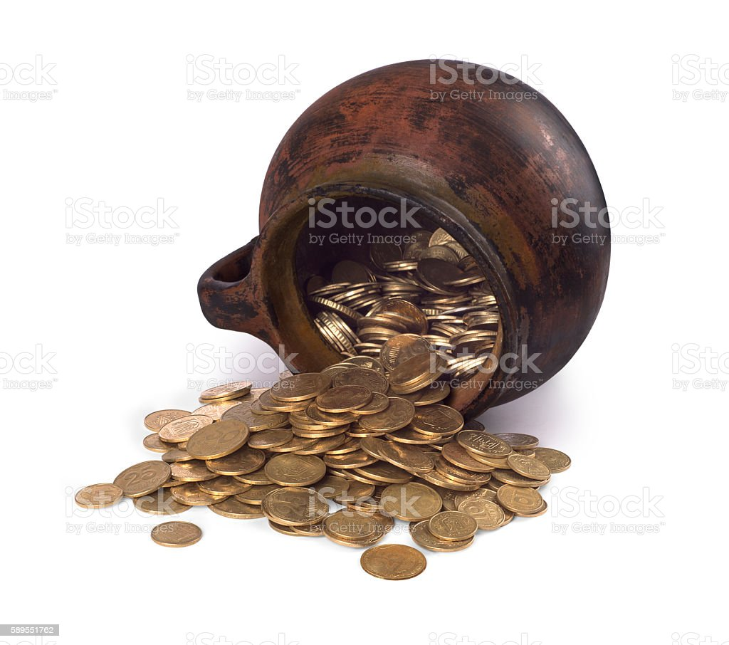 Clay pot with antique coins stock photo
