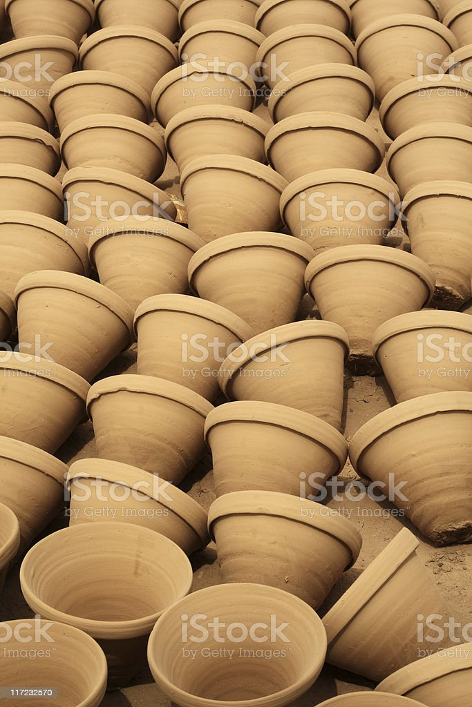 Clay Pots in Line Ready for Oven royalty-free stock photo