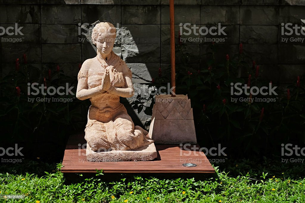 Clay praying women statue in the buddhist temple in Thailand stock photo