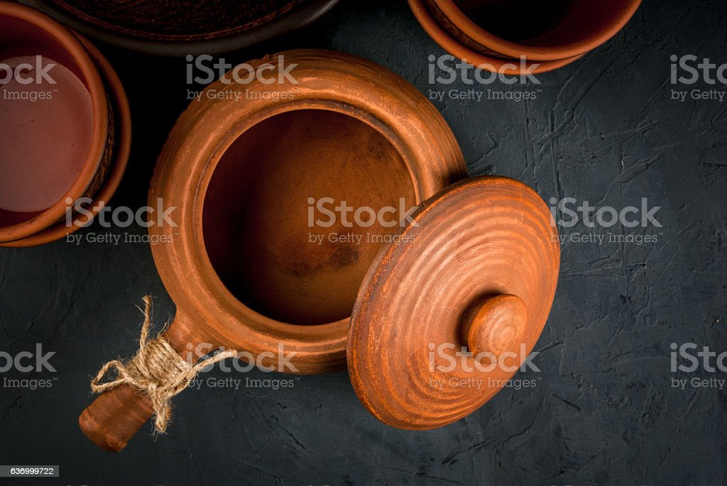 Clay rustic dishes on a stone  table stock photo