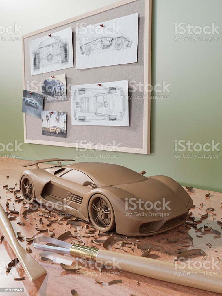 A clay sculpture of an automobile on a wooden surface stock photo