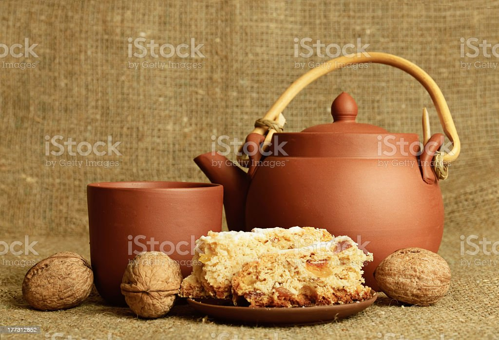 Clay teapot with sweets royalty-free stock photo