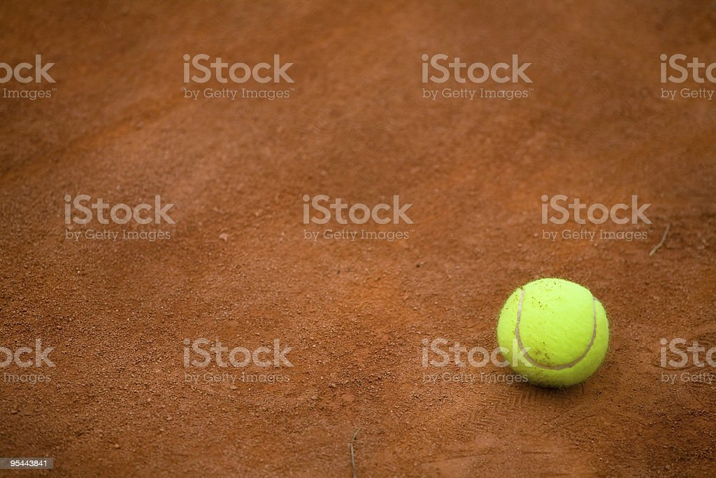 clay tennis court and tennisball royalty-free stock photo