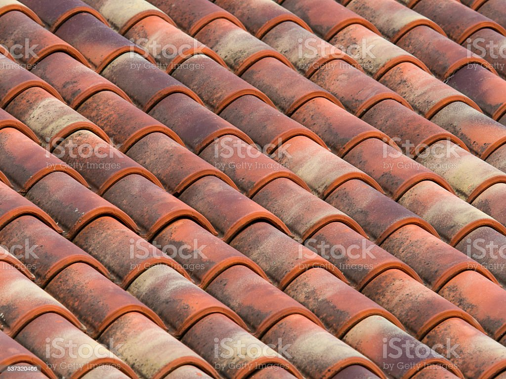 Clay (terracotta) tiles on the roof of a country house stock photo