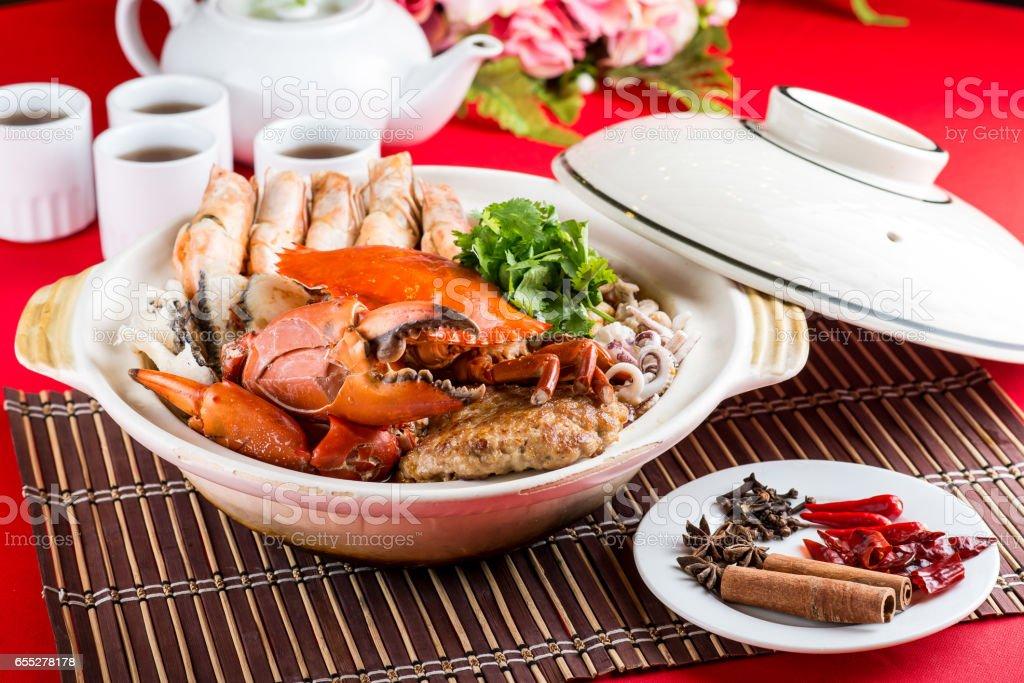 Claypot seafood bowl 龙虎烩 stock photo