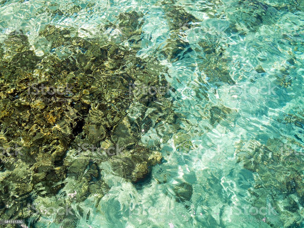 clean and clear deep emerald sea stock photo
