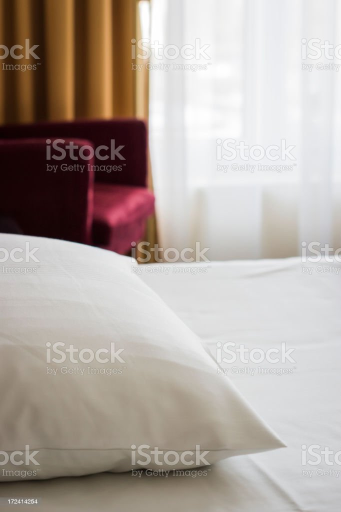 Clean and Comfortable Hotel Bed royalty-free stock photo